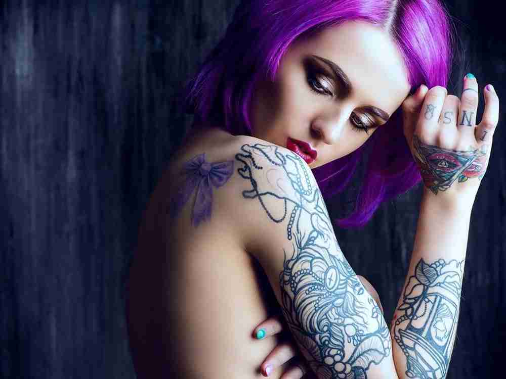 beautiful young woman flaunting her tattoo