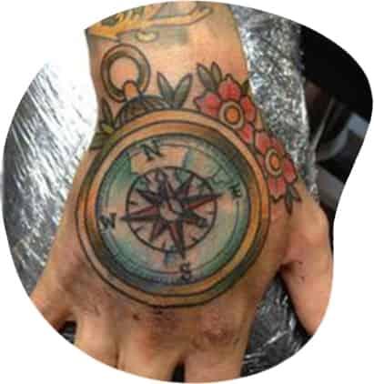a magnet design tattoo on hand