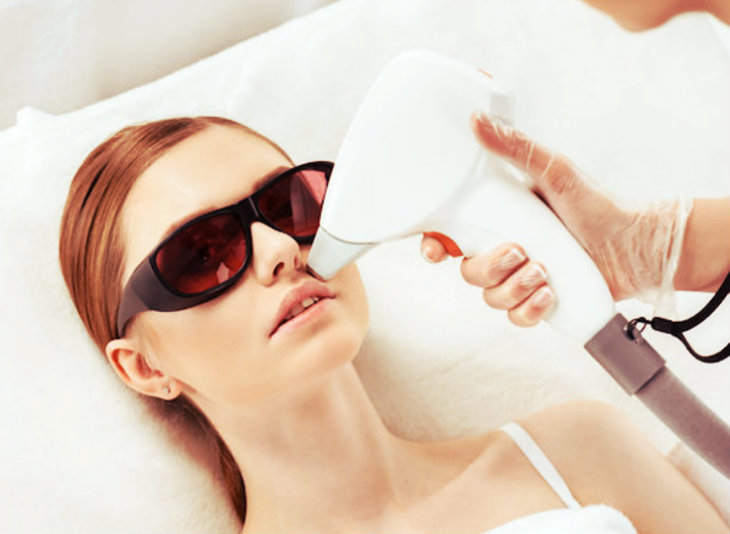 beautiful woman getting laser treatment done